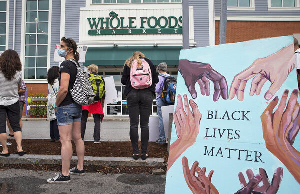 Protesters gathered outside a Whole Foods store in Cambridge, Mass., last month.