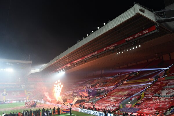 Liverpool's celebration in front of the Kop had lasers and fireworks and music — everything the team wanted, that is, except fans.