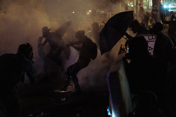 Federal forces and protesters clashed near the federal courthouse in Portland, Ore., early Wednesday.