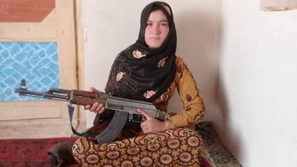 This photograph, made available by the Ghor district government, shows Qamar Gul, who fought off Taliban attackers who killed her mother and father.