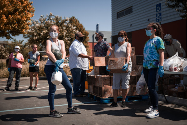 Volunteers handing out fresh groceries on Thursday at a food bank in Davis, Calif.