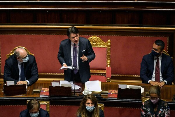 Prime Minister Giuseppe Conte of Italy, center, addressing the Senate in Rome this month.