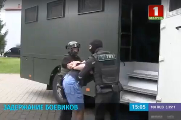 A screengrab from a news report by Belarus's state run news agency Belta shows agents arresting the alleged Russian mercenaries.