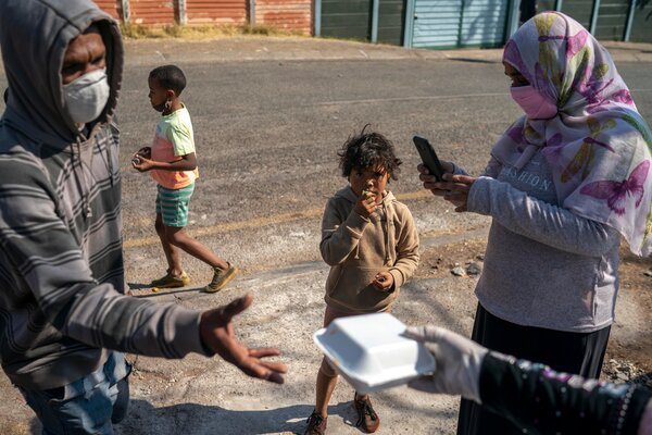 Hungry residents have turned to a soup kitchen run by volunteers in Coronationville,a suburb of Johannesburg, because government assistance has been lacking.  South Africa's Big Coronavirus Aid Effort Tainted by Corruption merlin 175084914 9348eee6 31dd 472f a78d 341581bb57d7 articleLarge