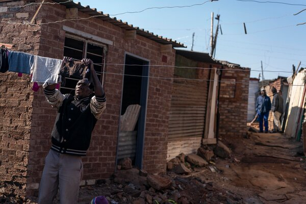 The pandemic has also hit workers who earn too much to qualify for state  grants, but whose income barely keeps them above the official poverty line.  South Africa's Big Coronavirus Aid Effort Tainted by Corruption merlin 175084992 44de0545 f2a3 40ae b12a 679e1afef256 articleLarge