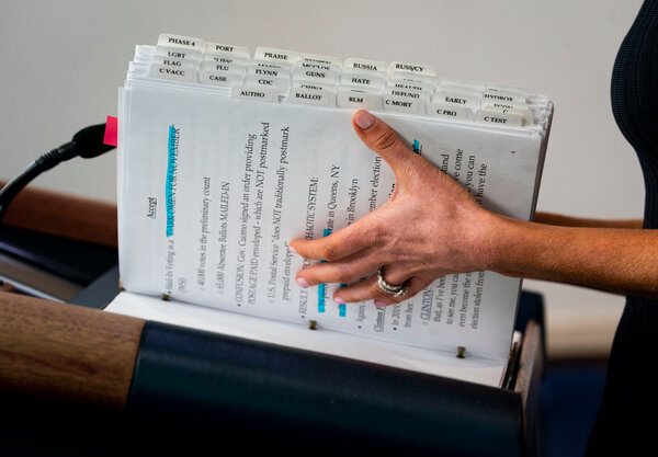 Ms. McEnany with her briefing binder last month.