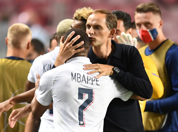 P.S.G. Coach Thomas Tuchel with Kylian Mbappé, whose entry as a substitute invigorated his team and whose assist delivering the winning goal.