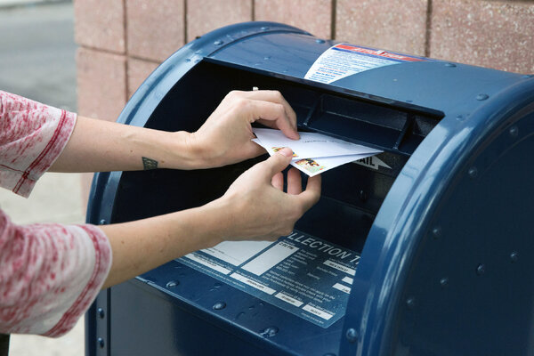 The Postal Service's inspector general said Friday that she opened an investigation into service complaints.