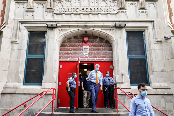 Mayor Bill de Blasio of New York at an elementary school in Brooklyn on Wednesday. The teachers' union is trying to ramp up pressure on the mayor to delay or call off his plan to reopen schools.
