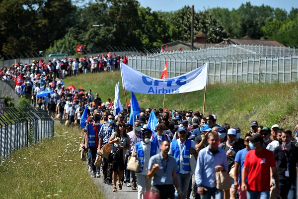 Airbus employees protesting cutbacks. The aircraft maker said it would eliminate 15,000 jobs.