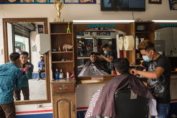 Roberto's brother, Marvin, at Rokuzzo, the barbershop founded by Roberto in Cubulco. Roberto left the business to his younger brothers before he began his journey to the United States.