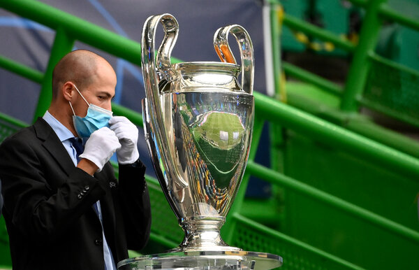 UEFA was able to award the Champions League trophy safely without an outbreak.  Soccer Played Through the Pandemic. Now It Has to Do It All Again. merlin 175903350 9bdb2508 54b2 48d7 b52e a7aa559c50ff articleLarge