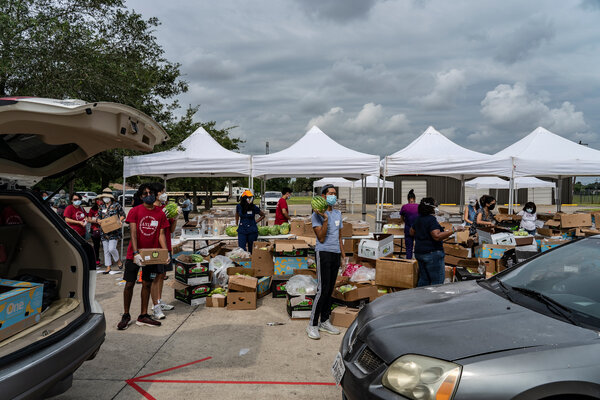 A drive-through food distribution site in Houston. The U.S. labor market continues to lurch through the pandemic with weekly jobless claims hovering around a million.