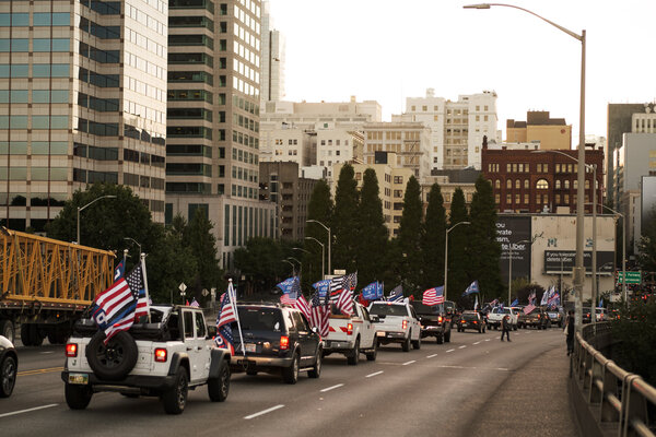 A man affiliated with a right-wing group was shot and killed on Saturday in Portland, Ore., where supporters of President Trump traveled in a caravan through the downtown area and clashed with protesters.