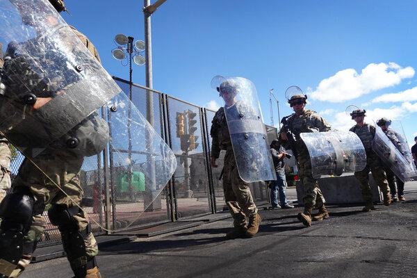 National Guard troops arrive in Kenosha, Wis., on Aug. 30.