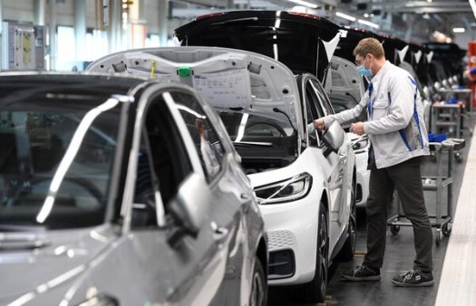 Assembling an ID.3 electric car at theVolkswagen plant in Zwickau, Germany.