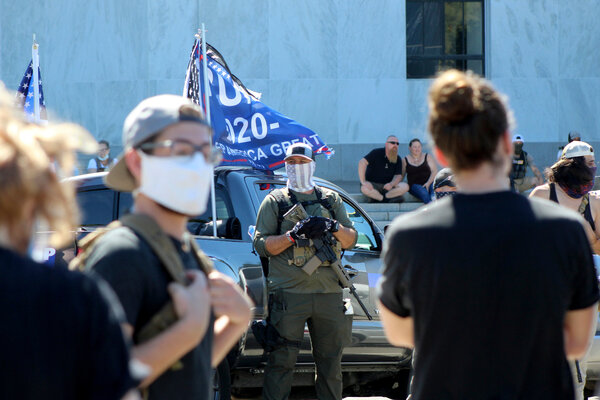 Security: Armed right-wing protesters outside the Oregon State Capitol in Salem, Ore., on Monday.