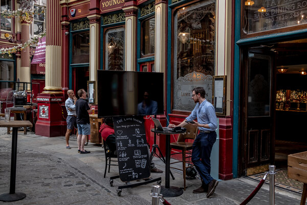 A pub in London after it reopened in July.The British economy grew 6.6 percent in July from the previous month.