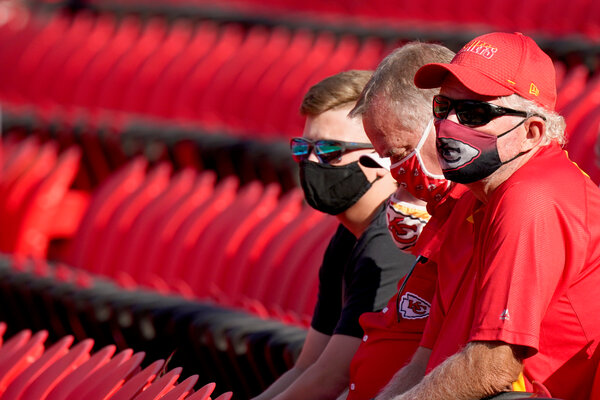Kansas City Chiefs fans watching a training camp practice at Arrowhead Stadium last month, while observing social distancing guidelines. For Thursday's game, the stadium will admit 22 percent of its normal capacity.