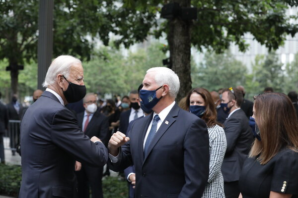 Joseph R. Biden Jr. greeted Vice President Mike Pence at a commemoration ceremony for the Sept. 11 terror attacks in Manhattan on Friday.