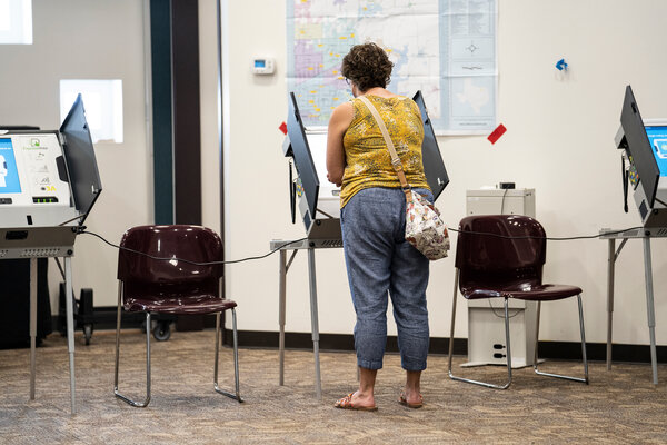 Texans show up to vote in the primary run-off elections at the Renner Frankford Branch Library in Dallas, Texas on July 14th.