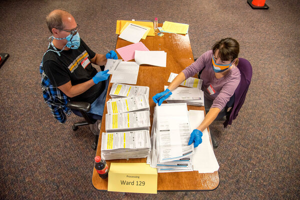 Election workers processing absentee ballots in Milwaukee last month.  Election Updates: Fires and Coronavirus Shadow Trump on Campaign Trail 14voting wisconsin3 articleLarge