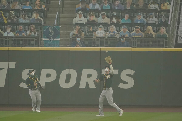Stephen Piscott and Ramon Laureano were both wearing masks while playing the outfield on Monday.
