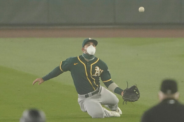 Ramon Laureano of the A's wore a mask.