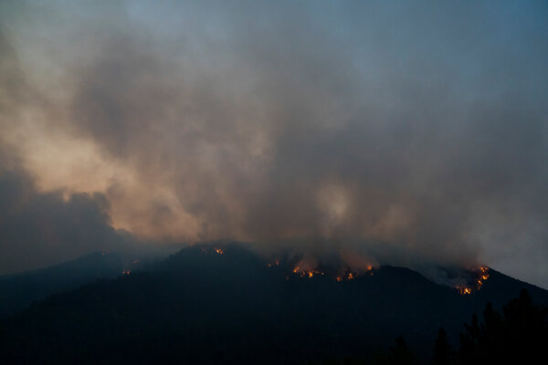 Firefighters battled the El Dorado Fire in Angelus Oaks, Calif., on Tuesday.