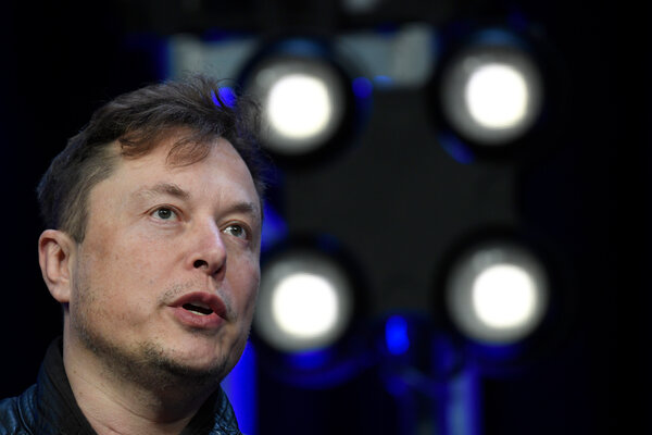 Elon Musk, the Tesla chief executive, said Tuesday that the company was developing cheaper, more powerful batteries for its electric cars, but many of the required innovations were still in progress.