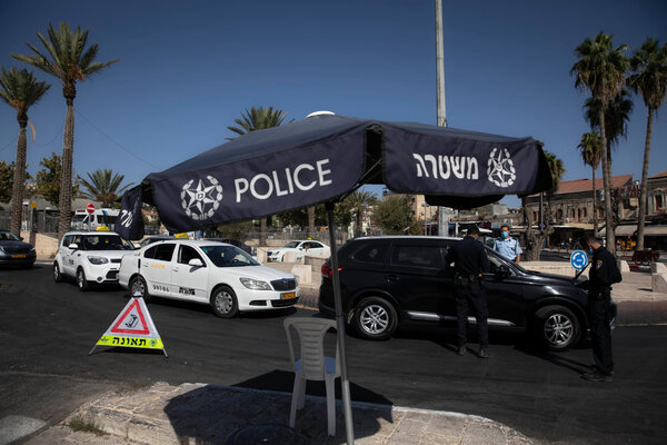 Israeli police officers enforced lockdown rules near the Damascus Gate in Jerusalem's Old City on Tuesday.