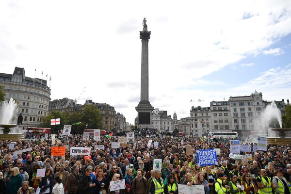 Protesters gathered in Trafalgar Square in London at a mass rally against vaccinations and coronavirus-related government restrictions.