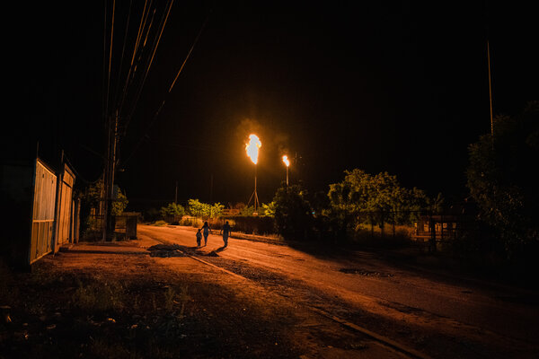 A gas flare lights the streets of Cabimas during a power outage.