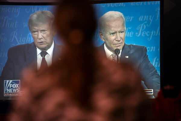 President Trump and Joseph R. Biden Jr. seen on a television Lititz, Pa., during their debate on Sept. 29.