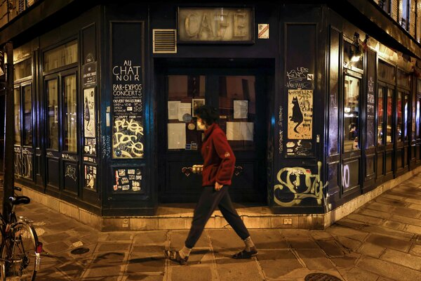 Au Chat Noir, a bar in Paris, is closed. France has reported a staggering number of new infections and put Paris and five other cities on maximum alert.