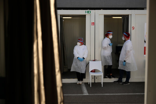Medical workers at Zaventem international airport issued coronavirus tests in Brussels last month.