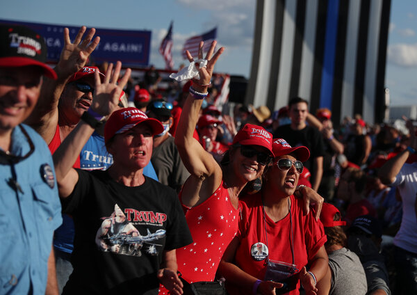 Trump supporters, most without masks, waiting for President Trump at the Orlando airport on Monday.