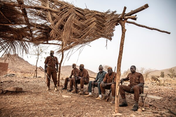 Members of the Koglweogo, a vigilante group accused of extra-judicial killings and other abuses targeting mostly people of the Fulani ethnic group, at their makeshift base in the town of Kongoussi in northern Burkina Faso in March 2020.