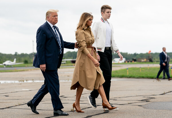 Barron Trump, who tested positive for the coronavirus, with his parents in August.