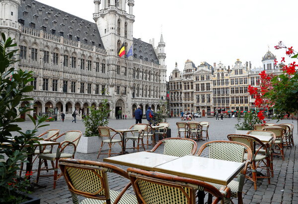 Empty seats in a restaurant on Brussels' Grand Place. The Belgian government announced strict new virus measures on Friday.