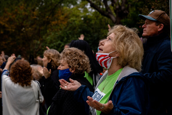 Supporters of Judge Barrett praying and singing near the Capitol on Tuesday.