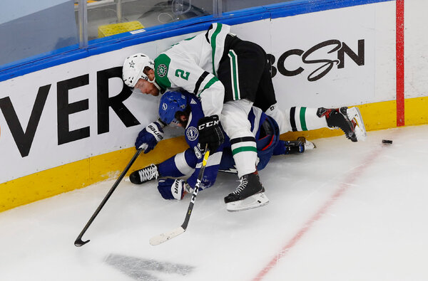 Dallas's Jamie Oleksiak, right, checking Nikita Kucherov of Tampa Bay. The two teams combined for more than 100 hits.
