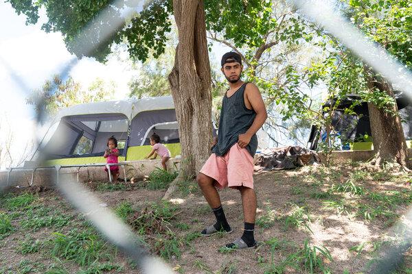 Rodrigo Castro de la Parra behind his family's tent in Matamoros in August.