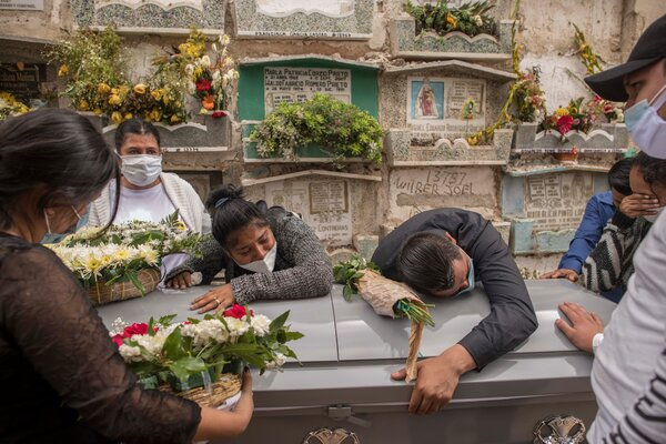 Cinthia and other relatives mourning Rodrigo at his funeral in Guatemala City.