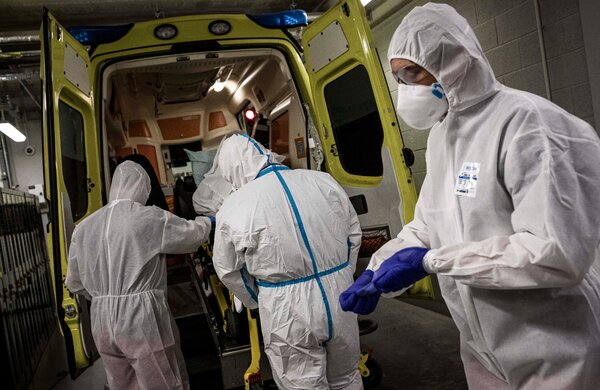 An ambulance arriving at a hospital in Liege, Belgium, on Friday. To fight one of the world's highest infection rates, the country is entering a new lockdown.