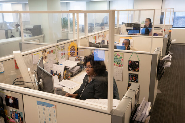 At SL Green, a real estate firm in Manhattan, employees sit in cubicles behind plastic barriers.