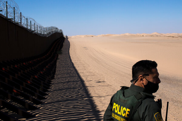 A Border Patrol Agent at the border wall near Gordon's Well Imperial Sand Dunes Park in California on Tuesday.
