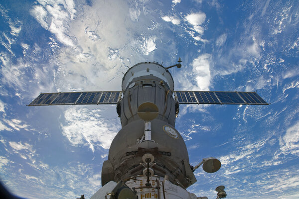 Astronauts huddled in the docked Soyuz spacecraft as debris from a passing satellite came within three miles of the space station in 2009.