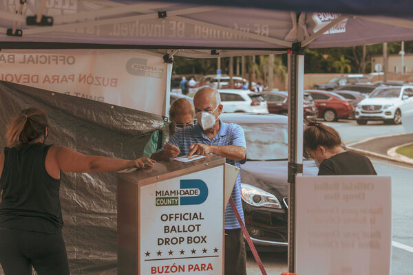 A voter signing his mail-in ballot at a drop box in Miami-Dade County last month.