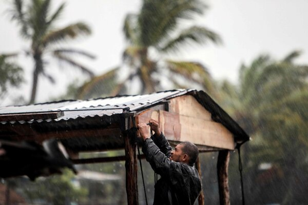 A man protected his beach house as Hurricane Eta approached in Bilwi, Puerto Cabezas, Nicaragua, on Monday.